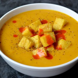 Creamy Carrot and Sweet Potato Soup with Crispy Polenta Croutons
